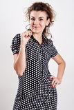 Beautiful woman in a black polka dot dress Royalty Free Stock Photo