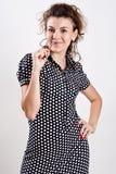 Beautiful woman in a black polka dot dress Royalty Free Stock Photo