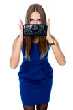 A beautiful woman with a black purse Royalty Free Stock Image