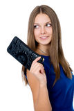 A beautiful woman with a black purse Royalty Free Stock Photography