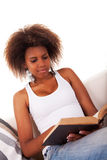 Beautiful woman black reading Stock Photos