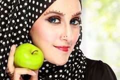 Beautiful woman with black scarf holding green apple Stock Images
