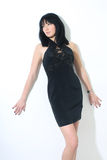 Beautiful woman in black sexy dress Royalty Free Stock Image
