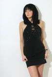 Beautiful woman in black sexy dress Stock Photography