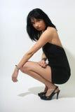 Beautiful woman in black sexy dress Royalty Free Stock Image