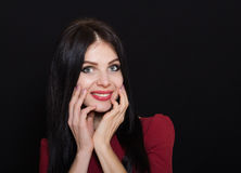 A beautiful woman with black straight hair and blue eyes in a burgundy dress Stock Photo