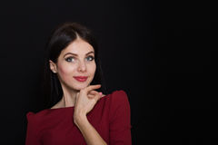 A beautiful woman with black straight hair and blue eyes in a burgundy dress Royalty Free Stock Images