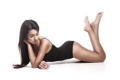 A beautiful lying woman in a black swimsuit Stock Images