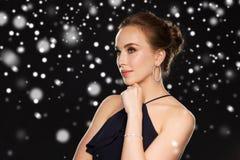 Beautiful woman in black wearing diamond jewelry Royalty Free Stock Photography