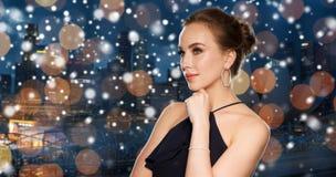 Beautiful woman in black wearing diamond jewelry Royalty Free Stock Photos