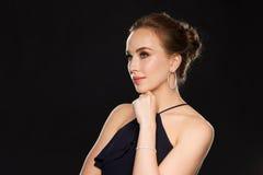 Beautiful woman in black wearing diamond jewelry Royalty Free Stock Photo