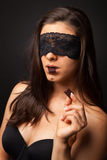Beautiful woman with blindfold sexy eating chocolate Royalty Free Stock Image