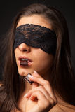 Beautiful woman with blindfold sexy eating chocolate Royalty Free Stock Photos