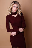 Beautiful woman with blond curly hair and evening makeup,wears elegant dress Royalty Free Stock Photo