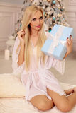 Beautiful woman with blond hair celebrating New Year holidays Stock Images