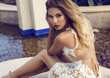 Beautiful woman with blond hair in elegant lace dress Stock Images