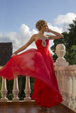 Beautiful woman with blond hair  in luxurious red dress Stock Image