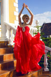 Beautiful woman with blond hair  in luxurious red dress Royalty Free Stock Images