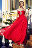 Beautiful woman with blond hair  in luxurious red dress Stock Images