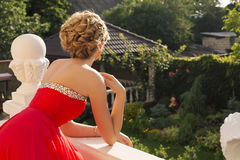 Beautiful woman with blond hair  in luxurious red dress Royalty Free Stock Photo