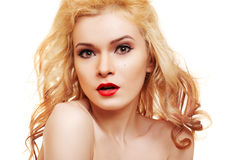 Beautiful woman with blond hair and luxury make-up royalty free stock photography