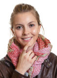 Beautiful woman with blond hair and scarf Stock Photos