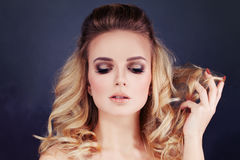 Beautiful Woman with Blonde Hair. Curly and Makeup Royalty Free Stock Photography
