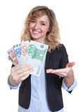 Beautiful woman with blonde hair and money Stock Photos