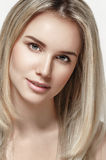 Beautiful woman blonde hair portrait close up studio on white Stock Image