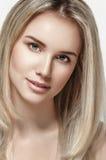 Beautiful woman blonde hair portrait close up studio on white Stock Image