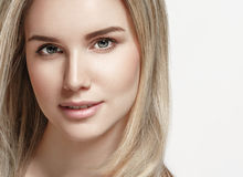 Beautiful woman blonde hair portrait close up studio on white Stock Images