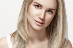 Beautiful woman blonde hair portrait close up studio on white Royalty Free Stock Image
