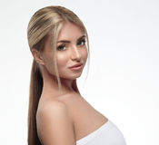 Beautiful woman blonde hair portrait close up studio on white long hair Stock Photography