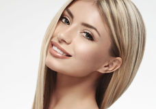 Beautiful woman blonde hair portrait close up studio on white long hair Royalty Free Stock Photo