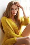 Beautiful woman blonde hair sitting next window natural makeup Royalty Free Stock Image