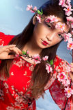 Beautiful woman with blooming peach tree Stock Photo