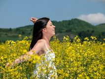 Beautiful woman in blooming rape. Photos taken in the spring of blossoming rape. Place of pictures of Slovakia and Polish frontier - 2012 Stock Photo