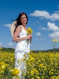 Beautiful woman in blooming. Photos taken in the spring of blossoming rape. Place of pictures of Slovakia and Polish frontier - 2012 stock image