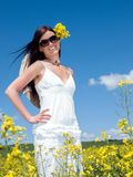 Beautiful woman in blooming. Photos taken in the spring of blossoming rape. Place of pictures of Slovakia and Polish frontier - 2012 royalty free stock image