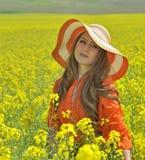 Beautiful woman on blooming rapeseed field Stock Image