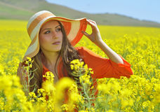 Beautiful woman on blooming rapeseed field Stock Photos