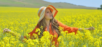 Beautiful woman on blooming rapeseed field Royalty Free Stock Photography