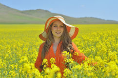 Beautiful woman on blooming rapeseed field Royalty Free Stock Images