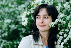 Beautiful woman in blossom flowers Stock Photos