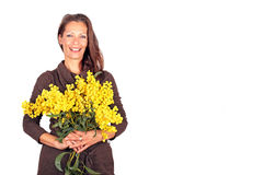 Beautiful woman with blossoming mimosa Stock Image