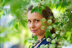 Beautiful fashion woman in a spring garden Royalty Free Stock Photo