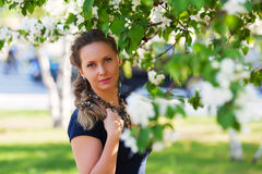 Beautiful fashion woman in a city park Stock Photography