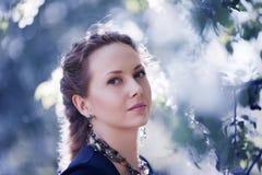 Beautiful woman among blossoming trees Royalty Free Stock Photos