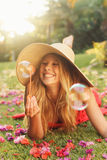 Beautiful Woman Blowing Bubbles Stock Photography