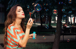 Beautiful woman blowing bubbles Royalty Free Stock Photos